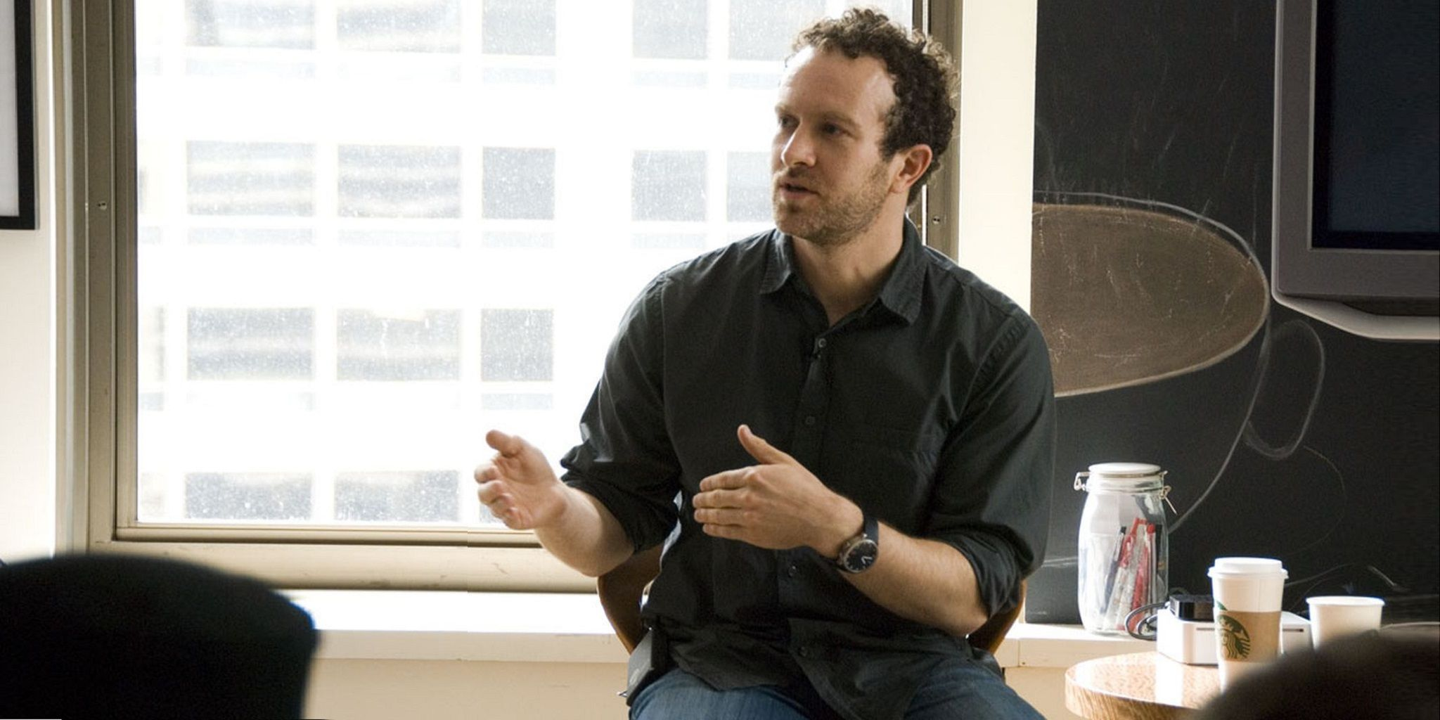 interview jason fried the founder and ceo of signals jason sitting on a desk